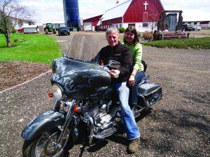 Karyn with husband on bike smaller