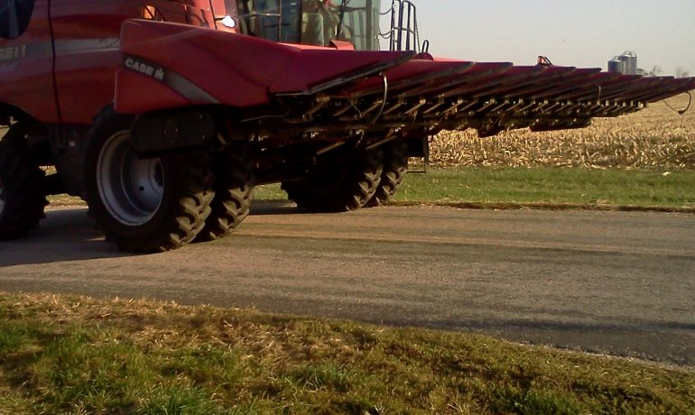 side view of combine on the road