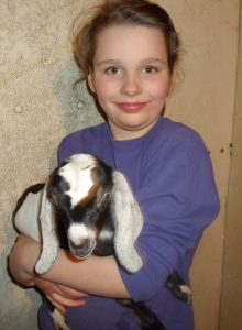 Anna holding a goat