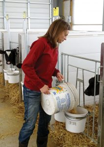 Andrea Brossard grain pouring