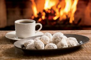 Recipe: Snowball Cookies 2 sticks (1 cup) butter, softened 1 1/2 cups powdered sugar, divided 1 teaspoon vanilla 2 1/4 cups flour 1/2 teaspoon salt 1 cup walnuts, finely chopped red and green sugar, optional Preheat oven to 350 degrees. In a large bowl, combine butter, ½ cup of powdered sugar, vanilla, flour, salt and walnuts. Using your hands, mix well. Roll into 1-inch balls. Bake cookies on an insulated baking sheet for 12-15 minutes, until light brown. When cool, roll in the remaining powdered sugar until well coated. Sprinkle with red or green sugar, if desired. Preparation Time: 15 minutes Cooking Time: 15 minutes Makes: 4 dozen