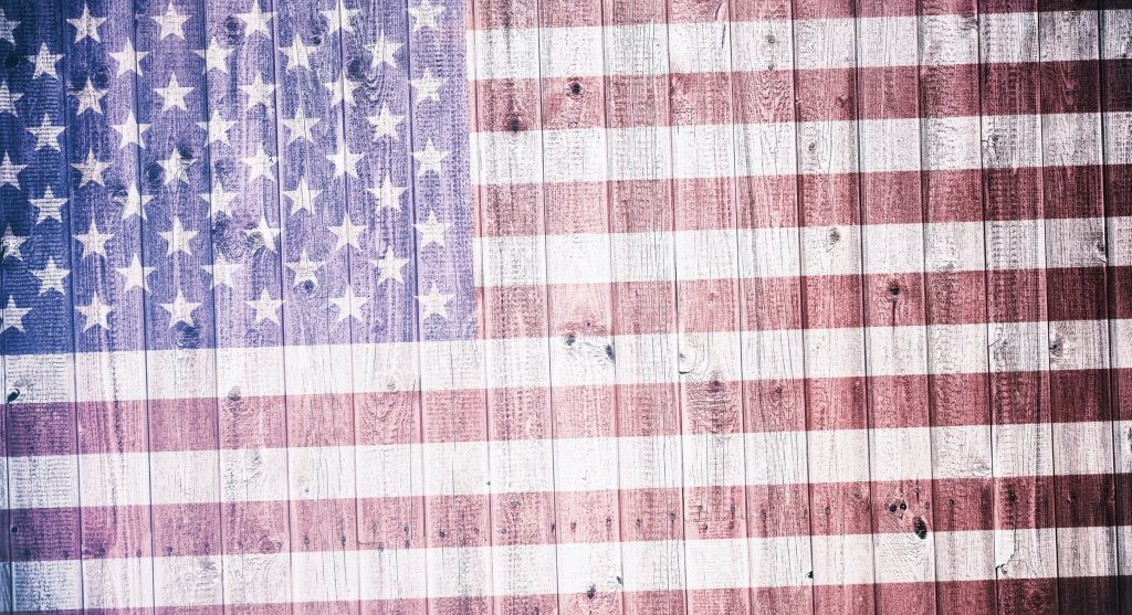 American flag on a wheatered wooden background, Composite in vintage look