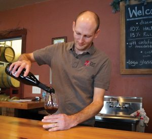 Vines and Rushes - Ryan Prellwitz pouring wine