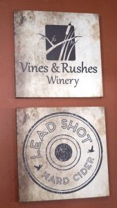 Vines and Rushes signs