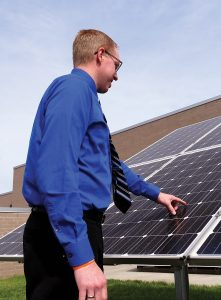 Adam Wehling with solar panel