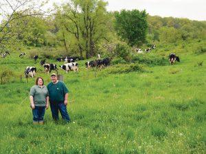 Adam and Amanda Heisner in pasture