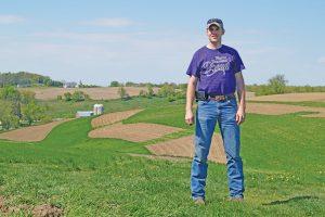 Derek Husmoen standing in field