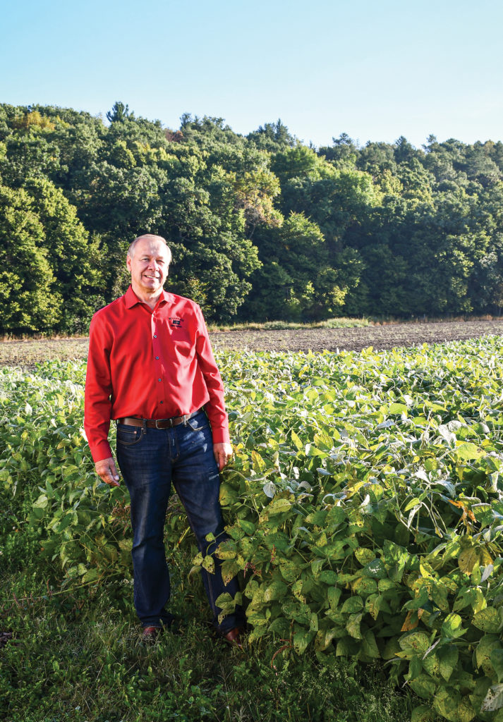 Jim Holte standing in soybean field.